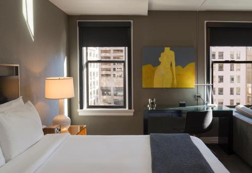 A bed or beds in a room at Hotel Max