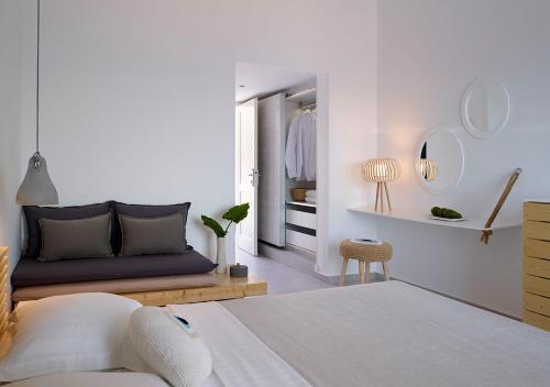 מיטה או מיטות בחדר ב-Proteas Blu Resort