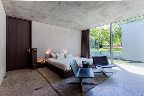"""Кровать или кровати в номере Notarishuys """"Pure Hotel"""""""