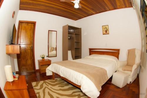 Cama ou camas em um quarto em Pousada Turmalinas