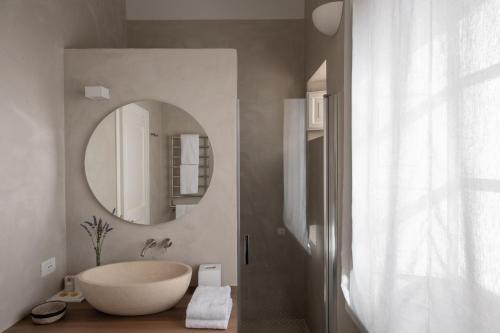 Ein Badezimmer in der Unterkunft Capofaro Locanda & Malvasia
