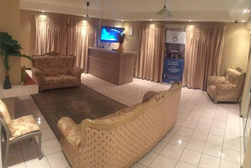 A seating area at Bridgeville Guest House( Pty) Ltd