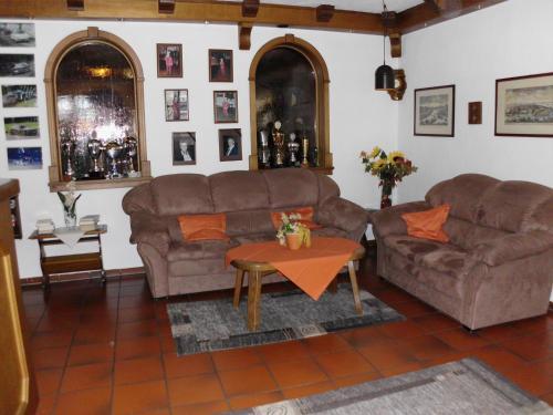 Ein Sitzbereich in der Unterkunft Hotel-Restaurant Zum Schwalbennest