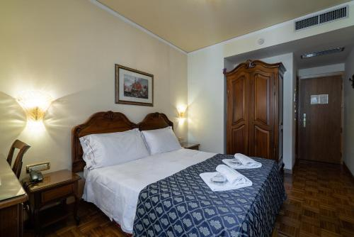 A bed or beds in a room at Hotel Spessotto