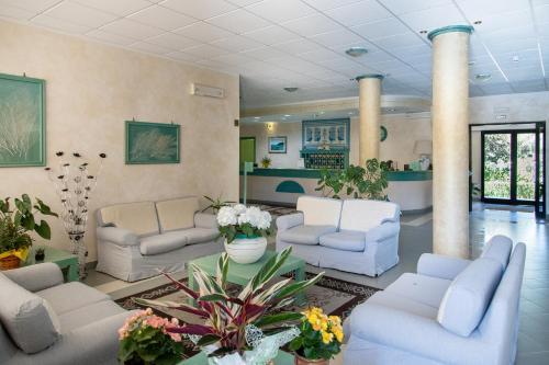 The lobby or reception area at Hotel Cala Dei Pini