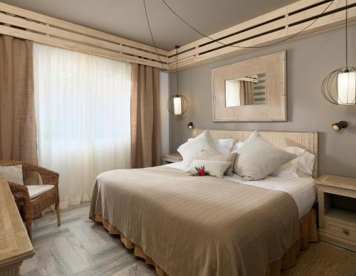 A bed or beds in a room at Green Garden Eco Resort & Villas