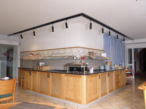 Ein Restaurant oder anderes Speiselokal in der Unterkunft Landhaus Bolzum