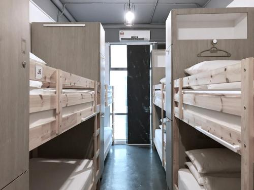 A bunk bed or bunk beds in a room at Faloe Hostel