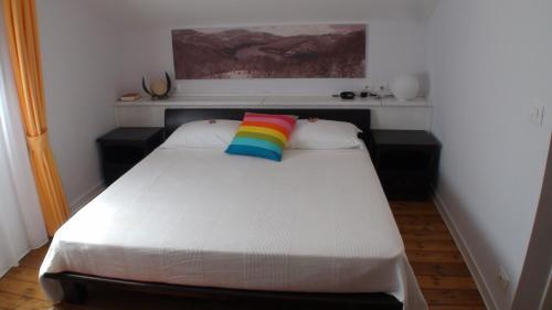 Letto o letti in una camera di Locanda Colle Cerqueto