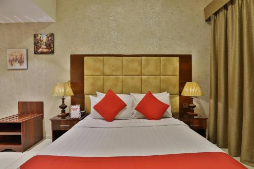 A bed or beds in a room at OYO 101 Click Hotel