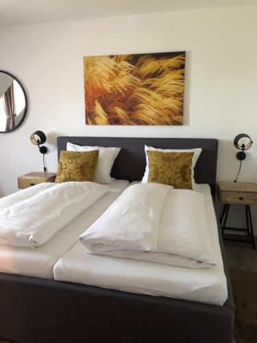 Кровать или кровати в номере Hotel Restaurant Haus Vorst