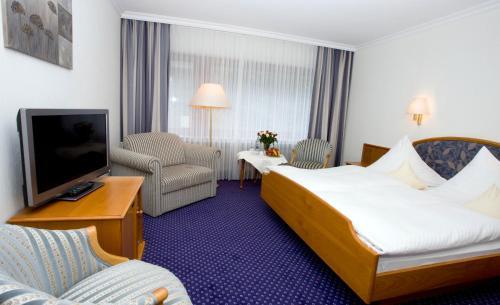 Ein Bett oder Betten in einem Zimmer der Unterkunft Urlaubs- und Wellnesshotel Friederike