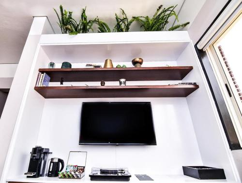 A television and/or entertainment center at Atelier Boutique Hotel