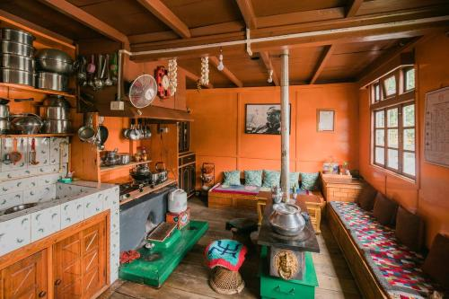 A kitchen or kitchenette at OurGuest Dhatup Homestay