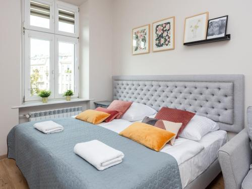 A bed or beds in a room at Wawel Apartments - Old Town