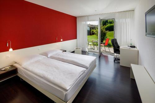 Ein Bett oder Betten in einem Zimmer der Unterkunft Hotel Stalden