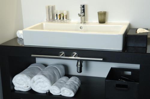Un baño de YOOMA Urban Lodge
