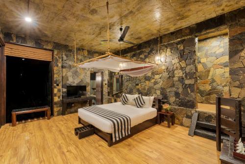 Postel nebo postele na pokoji v ubytování 98 Acres Resort & Spa