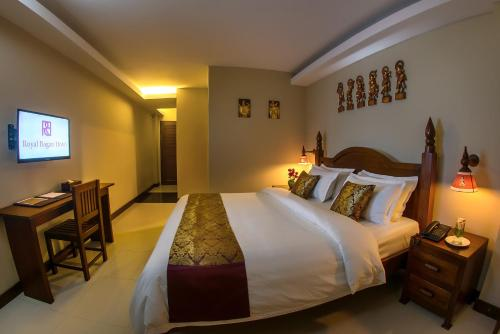 A bed or beds in a room at Royal Bagan Hotel