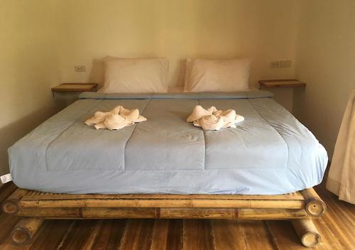 En eller flere senge i et værelse på Mook Montra Resort Sea Front