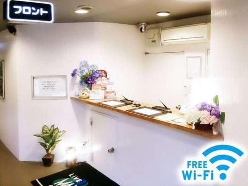 A kitchen or kitchenette at Hotel Livemax Omori-Ekimae