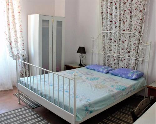 A bed or beds in a room at Nymph