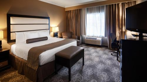 A bed or beds in a room at Best Western Plus Miami Airport North Hotel & Suites
