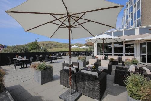 A restaurant or other place to eat at Fletcher Hotel Restaurant Zeeduin