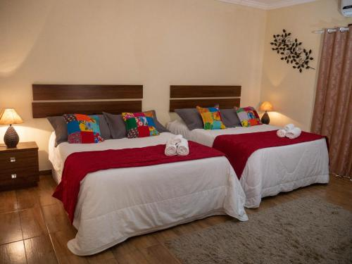 A bed or beds in a room at Recanto de Moriá