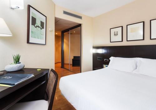 Cama o camas de una habitación en Hotel Sercotel Tudela Bardenas