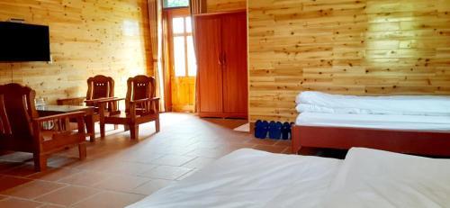Un ou plusieurs lits dans un hébergement de l'établissement Sa House Bac Ha