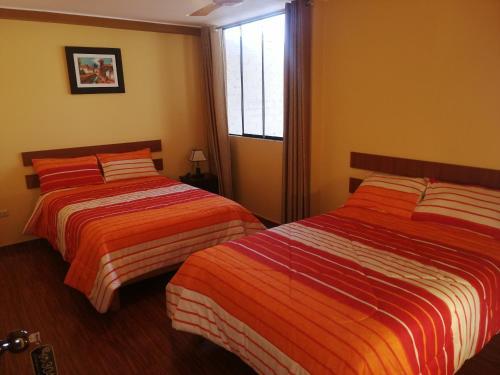 Un ou plusieurs lits dans un hébergement de l'établissement Nasca Travel One Hostel