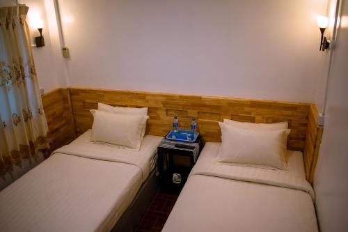 Ein Bett oder Betten in einem Zimmer der Unterkunft Ever New Guest House