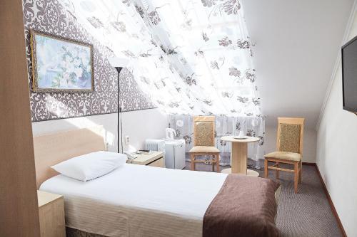 Кровать или кровати в номере Особняк на Театральной