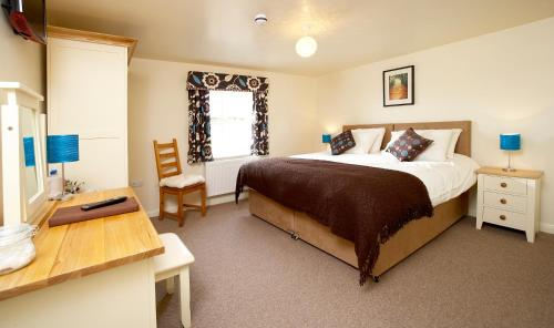 A bed or beds in a room at Highfield Farm