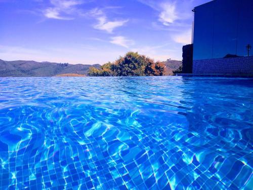 The swimming pool at or near Hotel Recanto da Serra