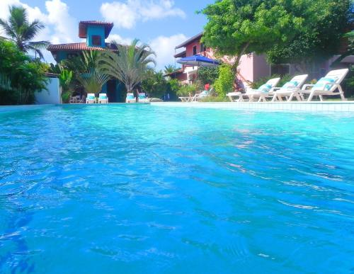 The swimming pool at or close to Ouro Sobre Azul Apart Hotel