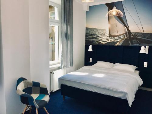 Łóżko lub łóżka w pokoju w obiekcie Apartament Pod Żaglami
