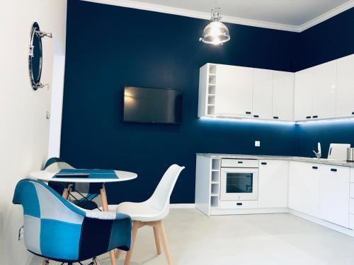 Telewizja i/lub zestaw kina domowego w obiekcie Apartament Pod Żaglami