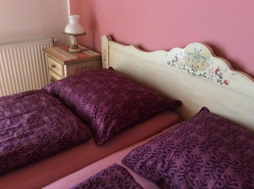 Ein Bett oder Betten in einem Zimmer der Unterkunft Almhaus Karantanien