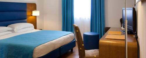 Un ou plusieurs lits dans un hébergement de l'établissement Hotel Plaza
