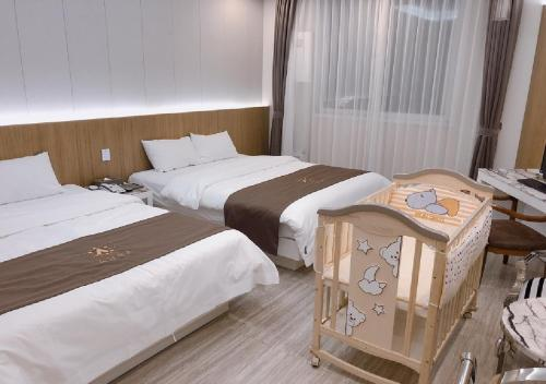 A bed or beds in a room at Gwangju Aura Hotel
