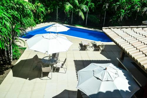 A view of the pool at Apartamento Solar dos Peixes or nearby