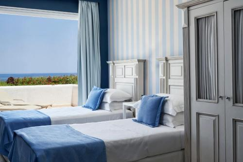 A bed or beds in a room at Elounda Gulf Villas