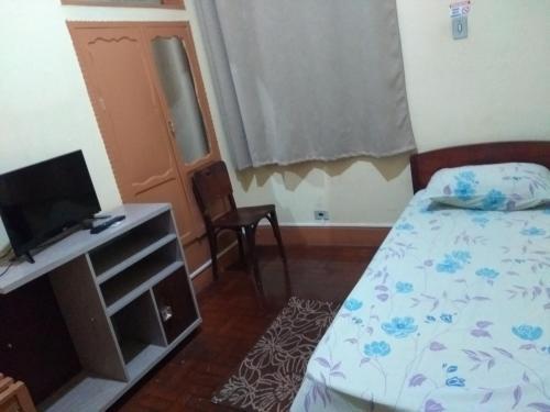 Cama ou camas em um quarto em Hotel Triunfo