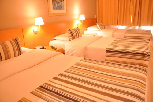 A bed or beds in a room at Augusto's Rio Copa Hotel