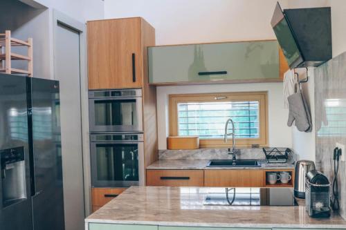 Kuchyňa alebo kuchynka v ubytovaní Stylish apartments at Penati Golf Resort