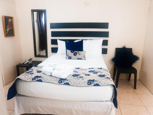 A bed or beds in a room at Eventuality B&B New Kingston