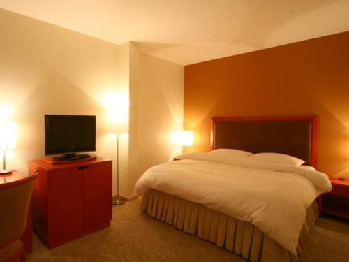 Cama ou camas em um quarto em Al Nimran Hotel