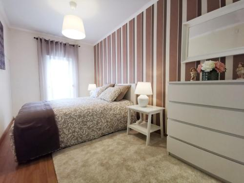 A bed or beds in a room at Prime Apartment - EXPO26